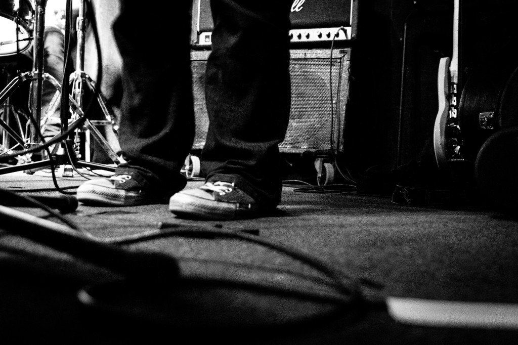 On the night our choir (The Septemberists) were performing, I figured this was an excellent opportunity to get some experience shooting photos of bands on stage. I set myself the challenge of shooting everything manually (exposure, f-stop etc). It was a complete disaster...so out of desperation I took a shot of some worn out sneakers, on sticky carpet and with an amp in the background. It said pretty much everything I wanted to say about rock n roll